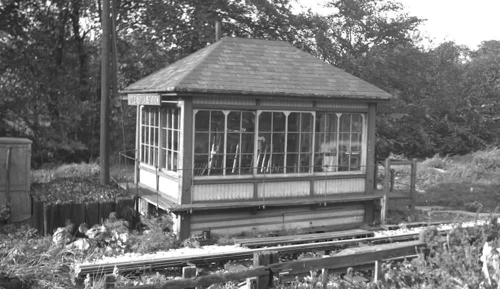 Little Eaton Station signal box photographed from the south east over the boundary fence, showing its non-steps end about 1965 by Pat Larkam - MRSC collection