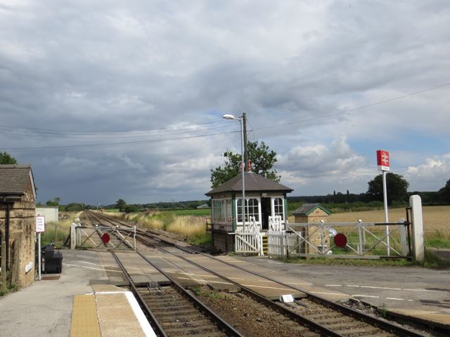 A view of Swinderby signal box from the down platform looking toward Lincoln